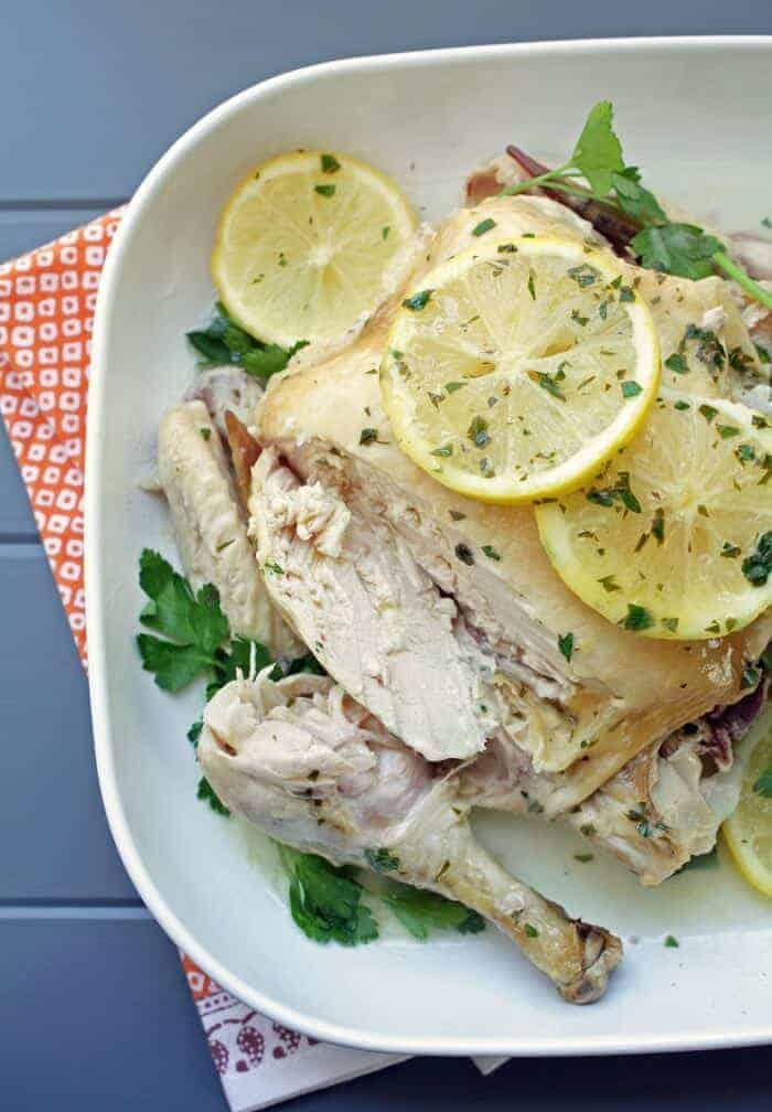 Paleo Easy Crock Pot Roasted Chicken with Lemon Parsley Butter